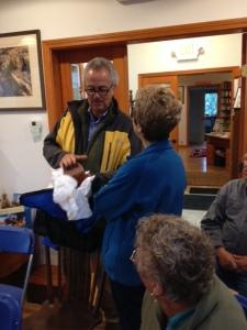 Joan Lester talks with Steve Black about his basket.