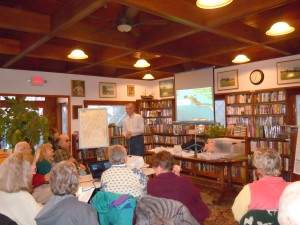Ed Robinson, a Trustee for the Harpswell Heritage Land Trust, spoke about the Harpswell walking trail system and trust properties under development. There was a capacity crowd in the Sue Fisher Moren Memorial Reading Room.