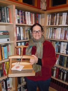 Lynette Bretton and her custom-made flower press.